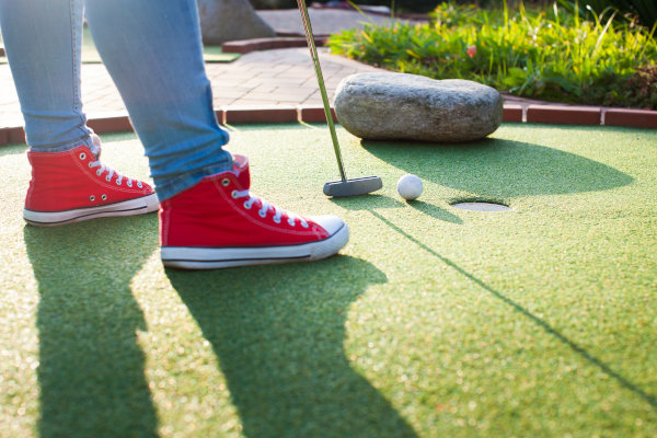 Detail,Of,Young,Woman,Playing,Mini/adventure,Golf,On,A,Beautiful